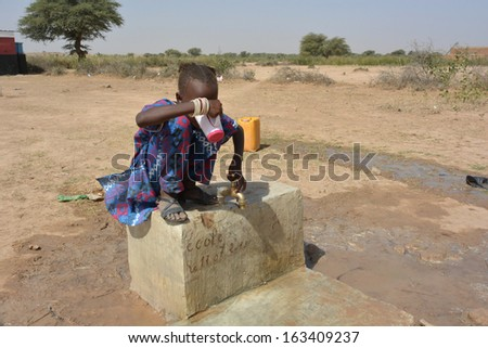 African child drinks water  - stock photo
