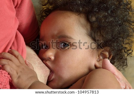 African child feeds him from the maternal breast - stock photo
