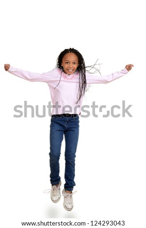 African child jumping in the air - stock photo
