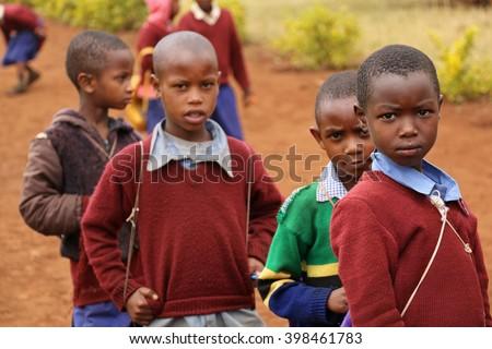 African Children at School / Schoolboys playing outdoors in a primary school near Karatu, Tanzania / Photo taken at Kambi ya Nyoka Primary School, Karatu, Tanzania on October 9, 2015. - stock photo