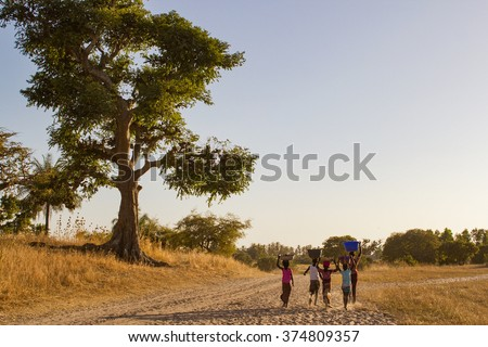 African children going back to the village. Senegal, Africa - stock photo