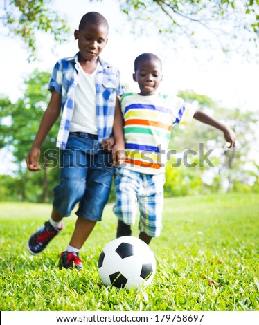 African Children Playing Ball In The Park - stock photo