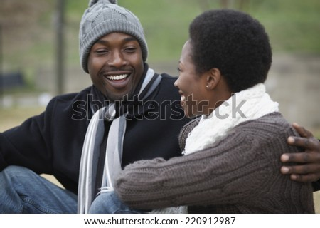 African couple smiling at each other - stock photo
