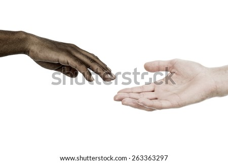 African descent woman and caucasian man reaching hands - stock photo