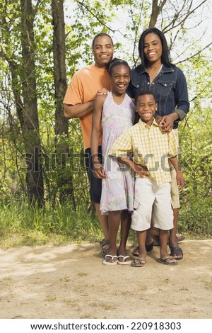 African family smiling in park - stock photo