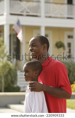African father and son standing outdoor - stock photo
