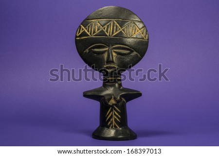 African Fertility Wooden Statuette Horizontal Photo - stock photo
