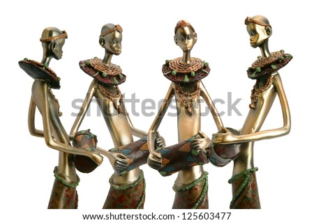African figurines holding drums - stock photo