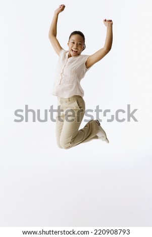 African girl jumping in air - stock photo