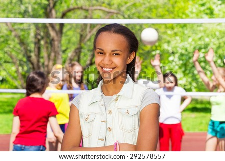 African girl on playground during volleyball game - stock photo