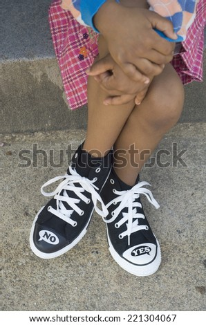 African girl with legs crossed - stock photo