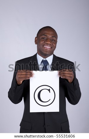 african lawyer businessman holding a copyright symbol - stock photo