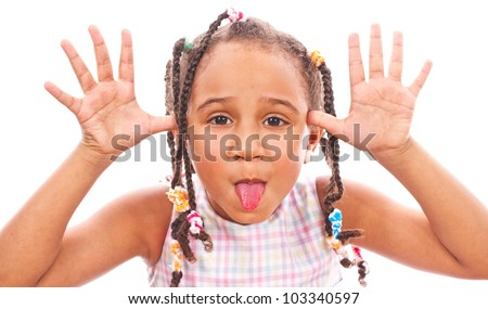 African little girl in shades sticking out her tongue - stock photo