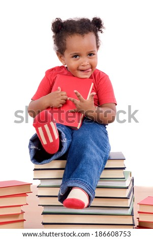 African little girl sitting on many books isolated on a white background - stock photo