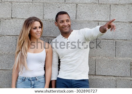 African man and caucasian girl. Young happy couple at outside - stock photo