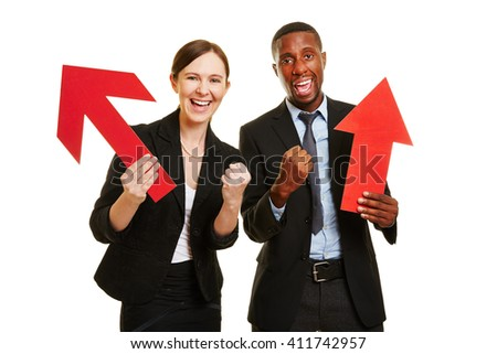 African man and caucasian woman cheering for motivation with red arrows - stock photo