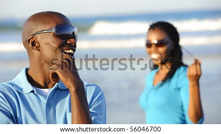 African man is laughing at his girlfriend in the background - stock photo