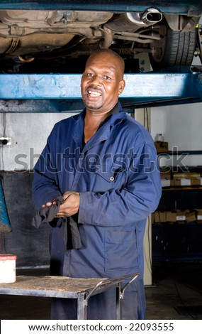 african mechanic in side garage - stock photo