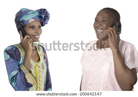 African mother and daughter talking on smart phone, Studio Shot - stock photo