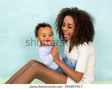 African mother playing with her 11 months old son - stock photo