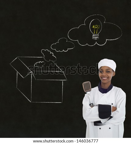 African or African American woman chef thinking out the box chalk concept blackboard background - stock photo