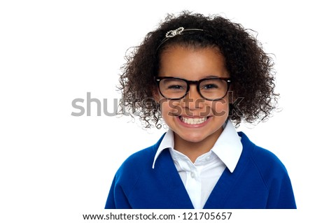 African origin bespectacled primary girl on a white background. - stock photo