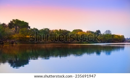 African river reflection - stock photo