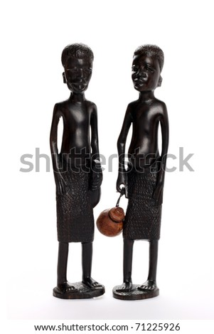 African statue isolated on white background - stock photo