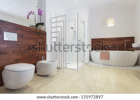 African style bathroom with exotic wood and free standing bath. - stock photo