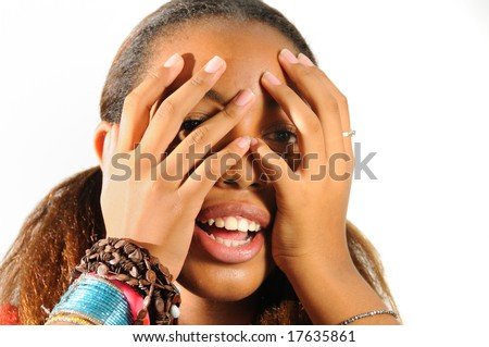 African teen girl with hands on the face - isolated - stock photo