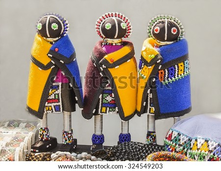 African unique rag dolls in traditional handmade colorful beads and fabrics clothes. Craftsmanship. African fashion.  Local craft market in South Africa. Ethnic costume of tribe Sesotho, Basotho.  - stock photo