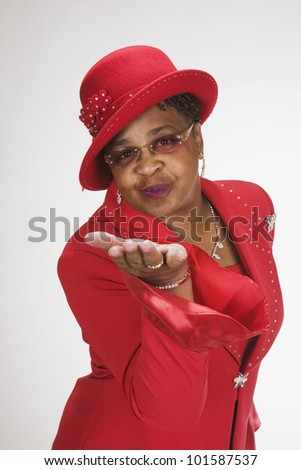 African woman blowing kiss - stock photo