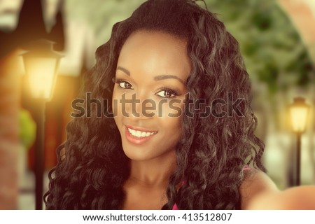 African woman doing selfie - stock photo