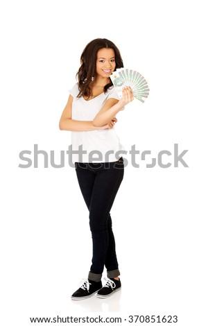 African woman holding polish money. - stock photo