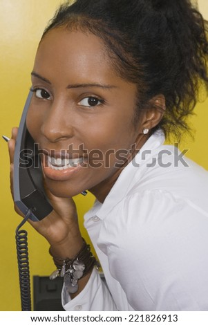 African woman talking on telephone - stock photo