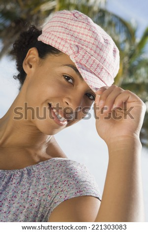 African woman wearing hat - stock photo