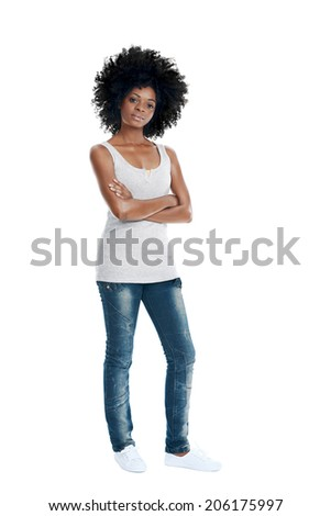 African woman with funky afro and casual clothing arms crossed in studio - stock photo