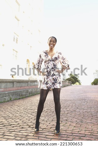 African woman with hands on hips - stock photo