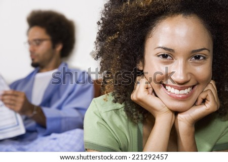African woman with husband in background - stock photo