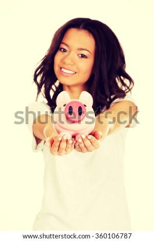 African woman with piggybank. - stock photo