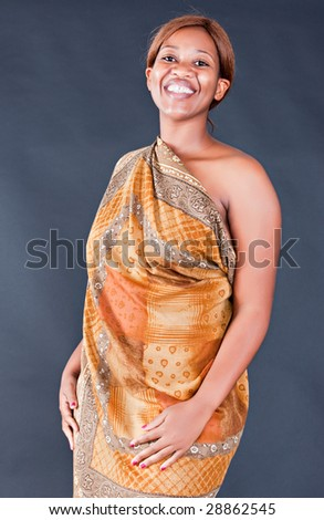 african woman with traditional clothing, dark background - stock photo