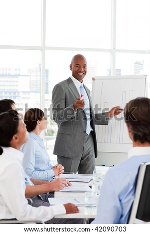 Afro-American businessman introducing stock market to his team in the office - stock photo