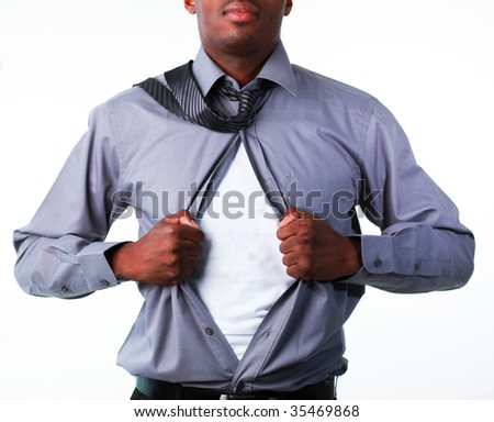 Afro-American businessman showing tshirt under his suit isolated against white - stock photo
