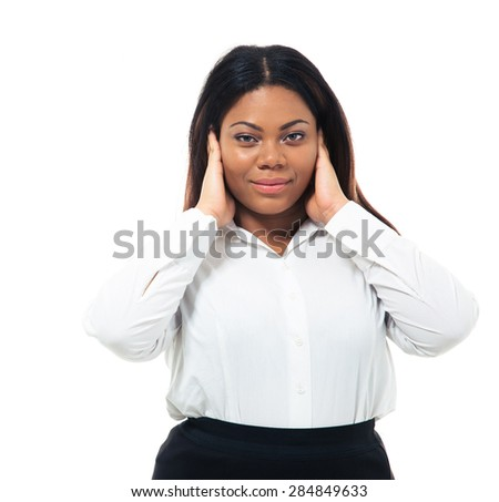 Afro american businesswoman covering her ears isolated on a white background. Looking at camera - stock photo