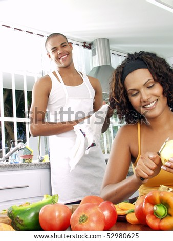 Afro american couple in a kitchen.   Latin couple cooking. - stock photo