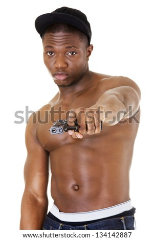 Afro american man standing with gun in hand. Thug and gangsta concept. - stock photo