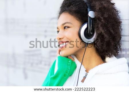 Afro-American with headphones - stock photo