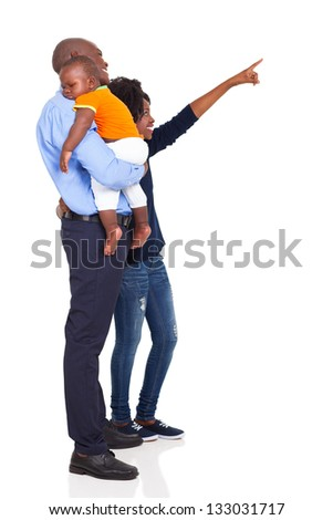afro american young family pointing at empty copy space isolated on white background - stock photo