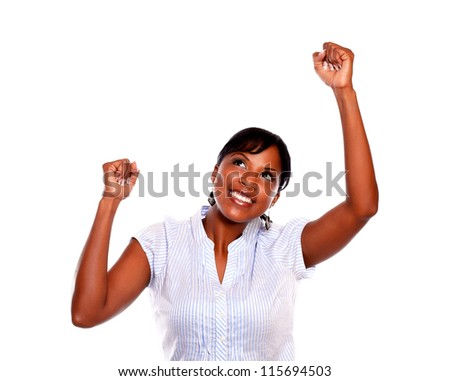 Afro-american young woman celebrating a victory on isolated background - stock photo