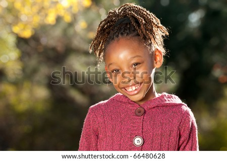 Afro girl enjoying nice sunny day in a park. - stock photo